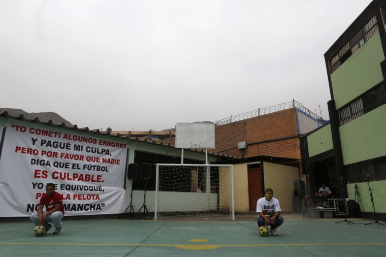 Men pose for a photograph in front of a goalpost in the Castro-Castro Prison in Lima, Peru on June 2, 2014. (REUTERS/ Mariana Bazo)