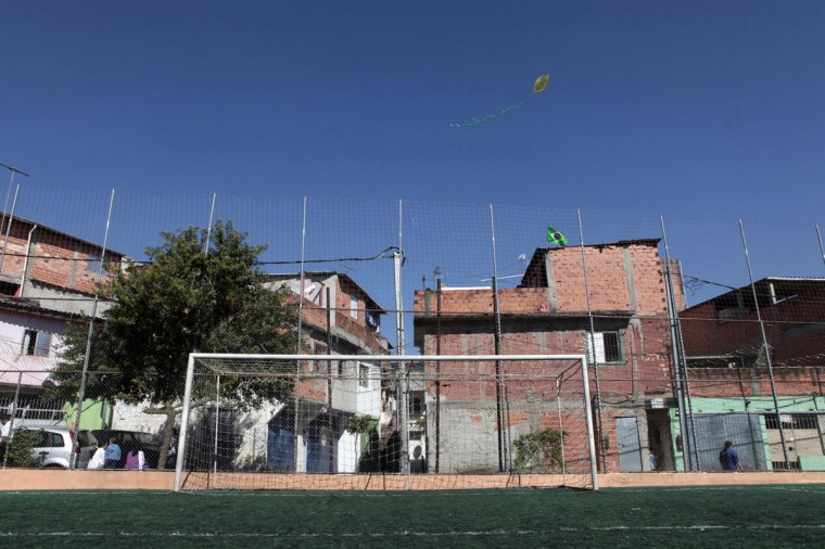 A kite flies above a goalpost at a playing field in a slum on the outskirts of Sao Paulo, Brazil on June 5, 2014. (REUTERS/Paulo Whitaker)