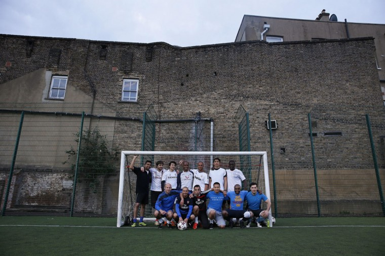 """Players for """"The Tuesdays"""" pose in a soccer goalpost at a training ground in Balham, south London on June 3, 2014. (REUTERS/Stefan Wermuth)"""