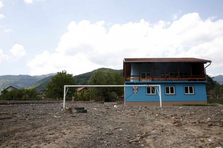 A soccer goalpost stands half buried in the ground after a major flood, at a stadium in Nemila, Bosnia and Herzegovina on June 3, 2014. (REUTERS/Dado Ruvic)