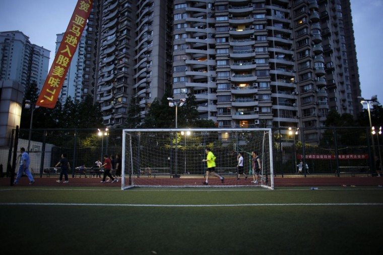 A soccer goalpost stands on a pitch in Luwan Sports Center in downtown Shanghai, China on May 30, 2014. (REUTERS/Carlos Barria)