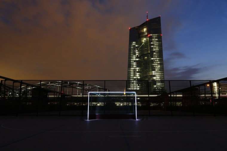 A photograph taken using long exposure shows a goalpost which has been illuminated with torches at a leisure facility in front of the European Central Bank (ECB) headquarters in Frankfurt, Germany on June 1, 2014. (REUTERS/Ralph Orlowski)