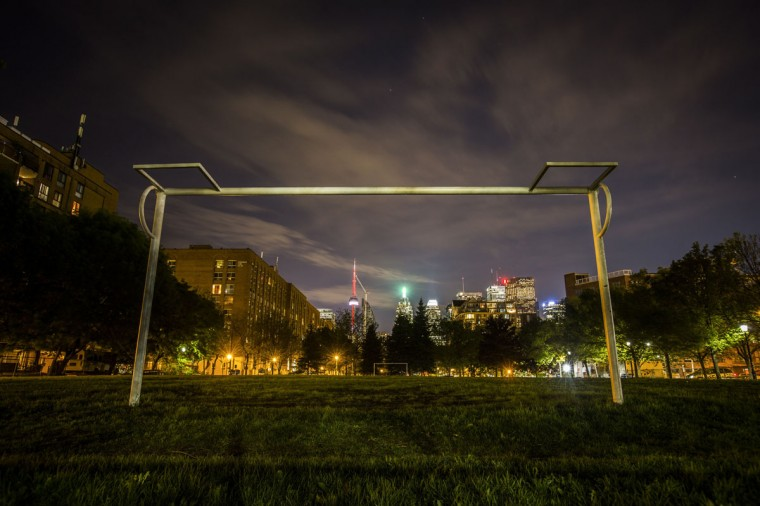 The city skyline is seen through a soccer goalpost in Toronto on May 27, 2014. (REUTERS/Mark Blinch)
