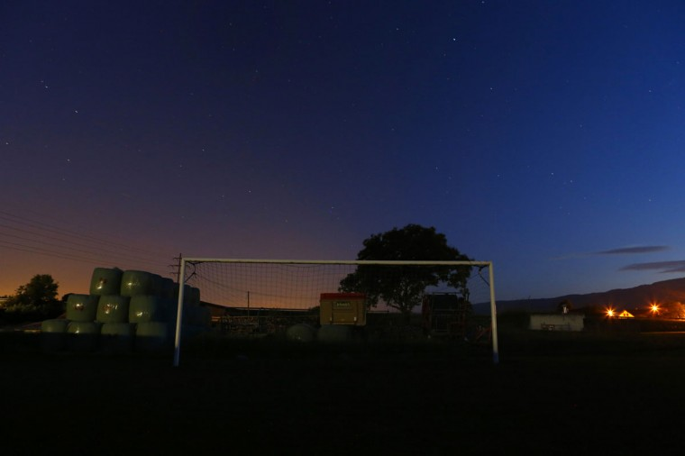 A goalpost stands in Duillier near Geneva, Switzerland on May 30, 2014. (REUTERS/Denis Balibouse)
