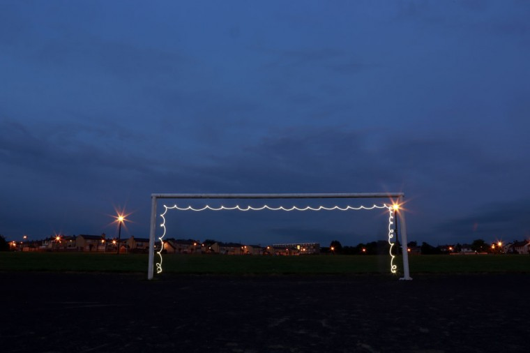 In a photograph taken using long exposure, a goalpost is illuminated by a flashlight at the Harpur's Hill housing estate in the town of Coleraine, Ireland on May 28, 2014. (REUTERS/Cathal McNaughton)