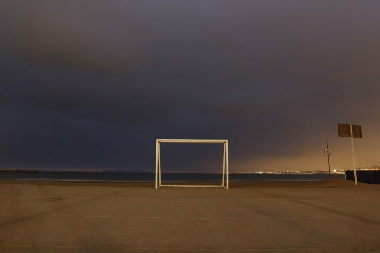 A soccer goalpost stands at Pescadores beach in Chorrillos, Lima, Peru on June 2, 2014. (REUTERS/Mariana Bazo)