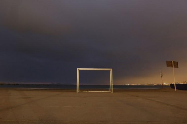 A soccer goalpost stands at Pescadores beach in Chorrillos, Lima, Peru on June 2, 2014. (REUTERS/Mariana Bazo)