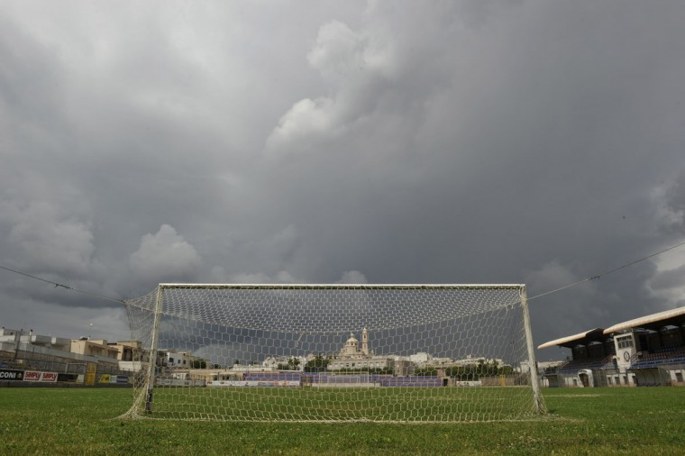 A cathedral is seen through a soccer goalpost in Locorotondo, south of Bari, southern Italy on May 31, 2014. (REUTERS/Alessandro Garofalo)