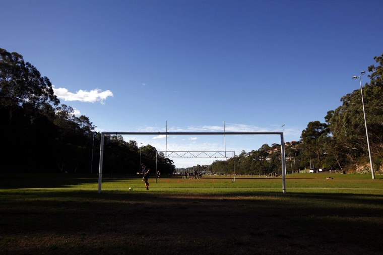 Children practice their soccer skills in front a goalpost in Tunks Park in Sydney, Australia on May 28, 2014. (REUTERS/David Gray)