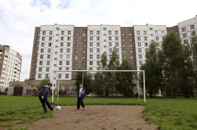 Boys play soccer in a schoolyard in Minsk, Belarus on June 4, 2014. (REUTERS/Vasily Fedosenko)