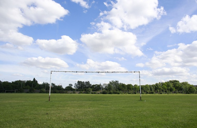 Soccer goalposts stand in a playing field in Hackney Marshes in east London on May 25, 2014. (REUTERS/Russell Boyce)