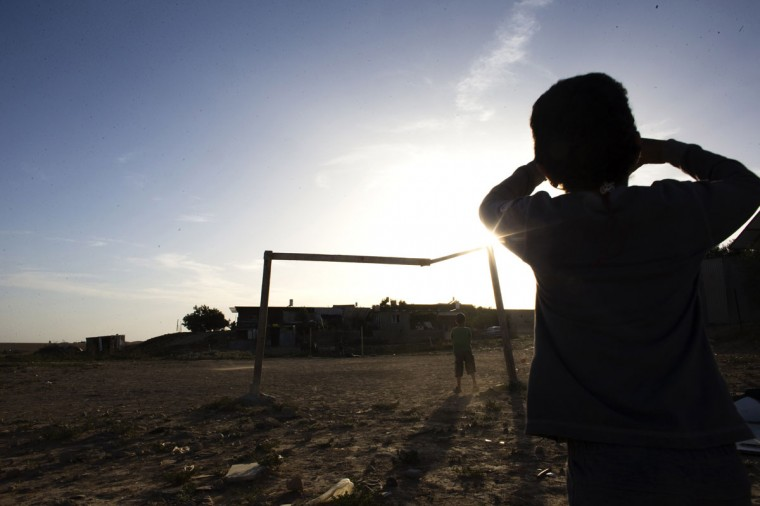Bedouin children play soccer in the village of al-Sira, one of the dozens of ramshackle Bedouin Arab communities in the Negev desert which are not recognized by the Israeli state, in southern Israel on June 2, 2014. (REUTERS/Ronen Zvulun)