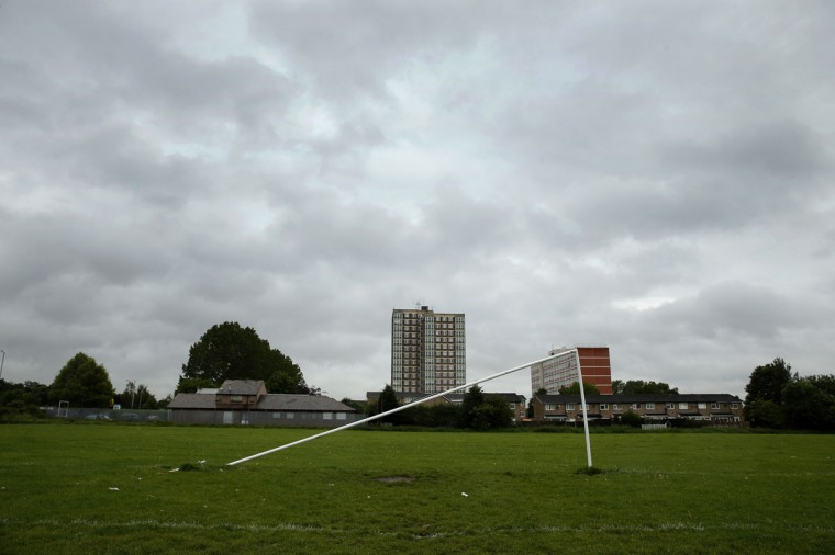 A broken soccer goalpost stands on a pitch in Wythenshawe Park near Manchester, northern England on March 29, 2014. (REUTERS/Phil Noble)