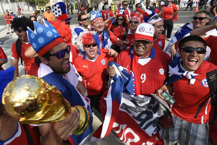 Chilian supporters cheer outside the Maracana Stadium before a Group B football match between Spain and Chile in Rio de Janeiro during the 2014 FIFA World Cup on June 18, 2014. Lluis Gene/AFP/Getty Images)