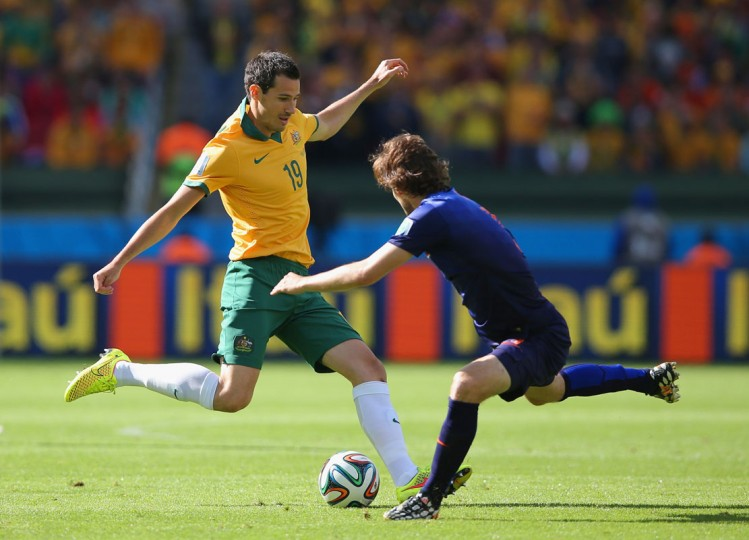 Ryan McGowan of Australia takes on Daley Blind of the Netherlands during the 2014 FIFA World Cup Brazil Group B match between Australia and Netherlands at Estadio Beira-Rio on June 18, 2014 in Porto Alegre, Brazil. (Photo by Dean Mouhtaropoulos/Getty Images)