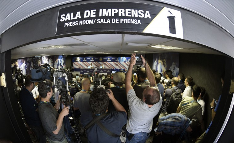 """Journalist attend a presser of Argentina's goalkeepers Agustin Orion and Mariano Andujar at their base camp """"Cidade do Galo"""" in Vespasiano, near Belo Horizonte, on June 18, 2014 ahead of a 2014 FIFA World Cup Brazil Group F football match against Iran to be held at the Mineirao Stadium in Belo Horizonte on June 21. (Juan Mabromata/AFP/Getty Images)"""