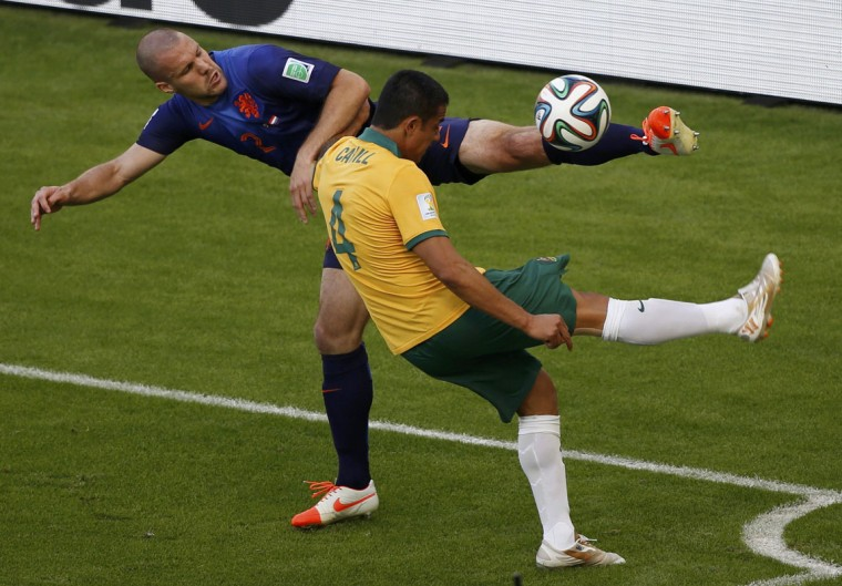 Ron Vlaar of the Netherlands kicks the ball near Australia's Tim Cahill (4) during their 2014 World Cup Group B soccer match at the Beira Rio stadium in Porto Alegre June 18, 2014. (Marko Djurica/Reuters)
