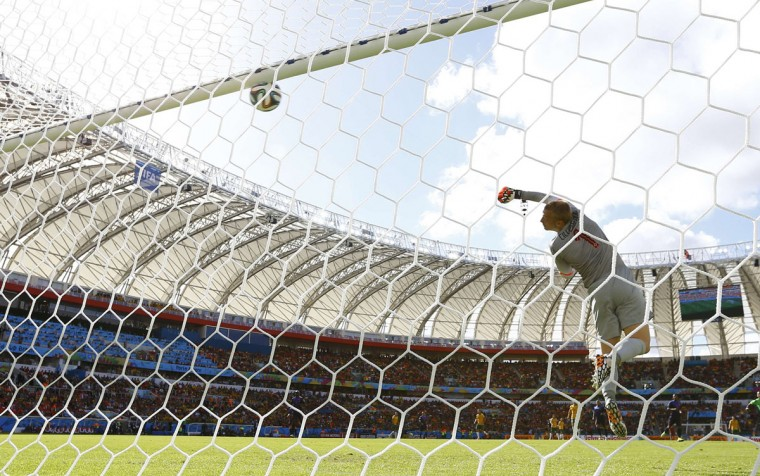 Goalkeeper Jasper Cillessen of the Netherlands lets in a goal by Australia's Tim Cahill during their 2014 World Cup Group B soccer match at the Beira Rio stadium in Porto Alegre June 18, 2014. (Darren Staples/Reuters)