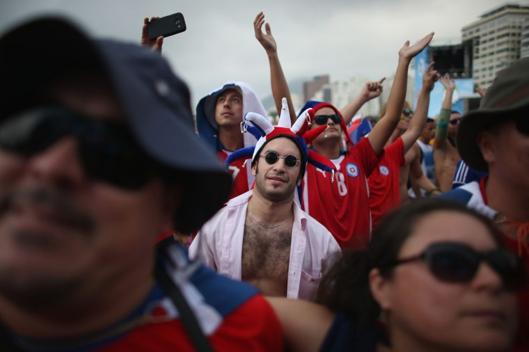 Chilean soccer team fans wait for their team to take the field against Spain while watching it on the screen setup at the FIFA Fan Fest during the World Cup tournament on June 18, 2014 in Rio de Janeiro, Brazil. A 5-1 defeat against Holland in Spain's first game leaves the world champions on the edge of a first-round knockout. (Photo by Joe Raedle/Getty Images)