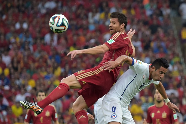 Spain's midfielder Xabi Alonso (L) and Chile's defender Mauricio Isla vie for the ball during a Group B football match between Spain and Chile in the Maracana Stadium in Rio de Janeiro during the 2014 FIFA World Cup on June 18, 2014. (Gabriel Bouys/AFP/Getty Images)