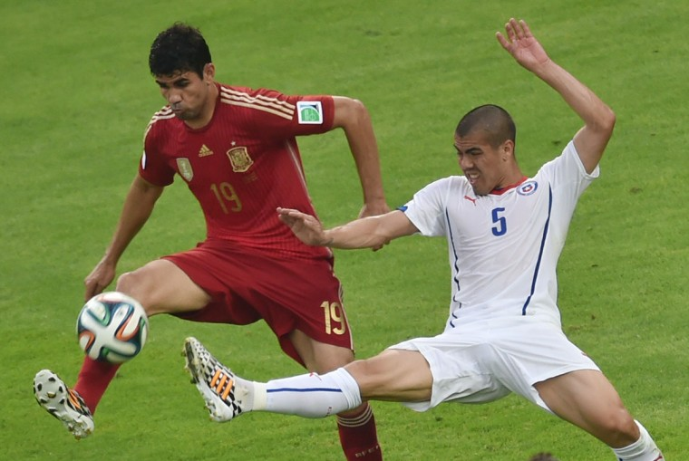Spain's forward Diego Costa (L) and Chile's midfielder Francisco Silva vie for the ball during a Group B football match between Spain and Chile in the Maracana Stadium in Rio de Janeiro during the 2014 FIFA World Cup on June 18, 2014. (Yasuyoshi Chiba/AFP/Getty Images)