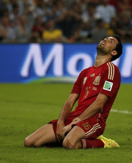 Spain's Sergio Busquets reacts after missing a chance to score a goal during their 2014 World Cup Group B soccer match against Chile at the Maracana stadium in Rio de Janeiro June 18, 2014. (Jorge Silva/Reuters)
