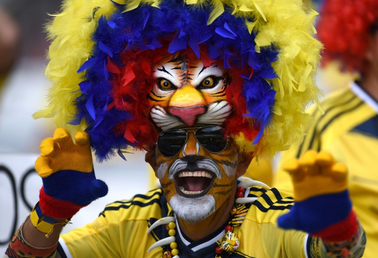 A Colombian supporter waits for the start of a Group C football match between Colombia and Greece at the Mineirao Arena in Belo Horizonte during the 2014 FIFA World Cup on June 14, 2014. (Pedro Ugarte/AFP/Getty Images)