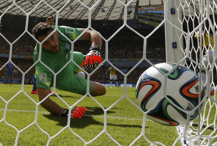 Greece's Orestis Karnezis watches as the ball goes into the net in a goal scored by Colombia's Pablo Armero (unseen) during their 2014 World Cup Group C soccer match at the Mineirao stadium in Belo Horizonte June 14, 2014. (Paulo Whitaker/Reuters)