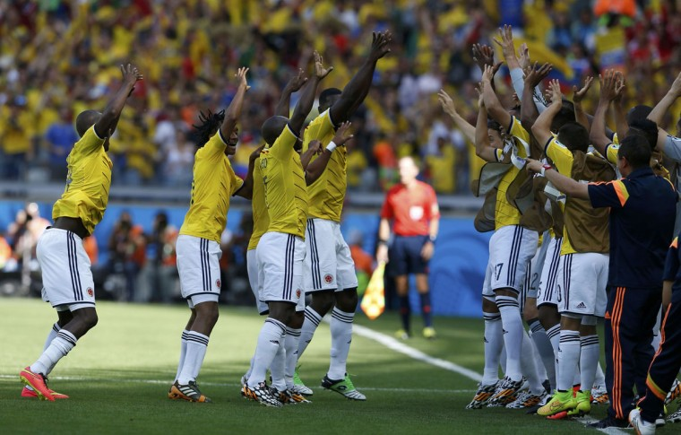 Colombia's players celebrate their goal during the 2014 World Cup Group C soccer match between Colombia and Greece at the Mineirao stadium in Belo Horizonte June 14, 2014. (Sergio Perez/Reuters)