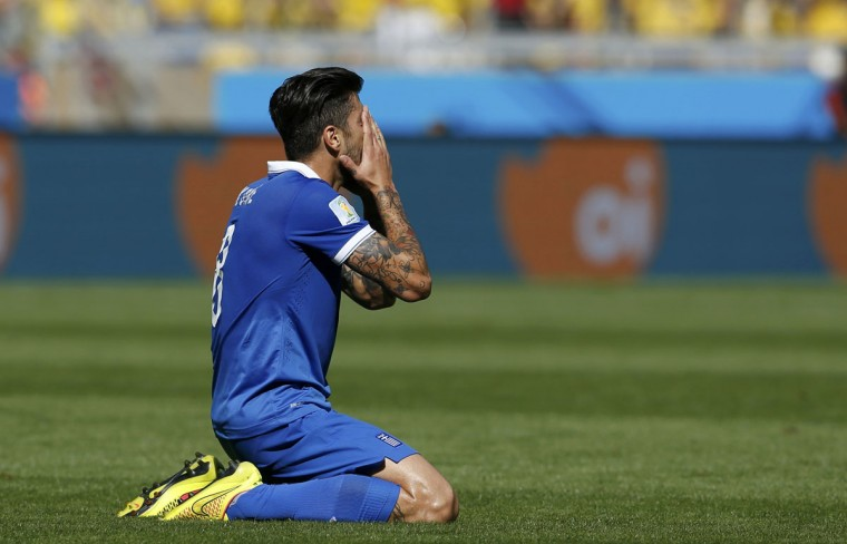 Greece's Panagiotis Kone reacts during the 2014 World Cup Group C soccer match between Colombia and Greece at the Mineirao stadium in Belo Horizonte June 14, 2014. (Sergio Perez/Reuters)