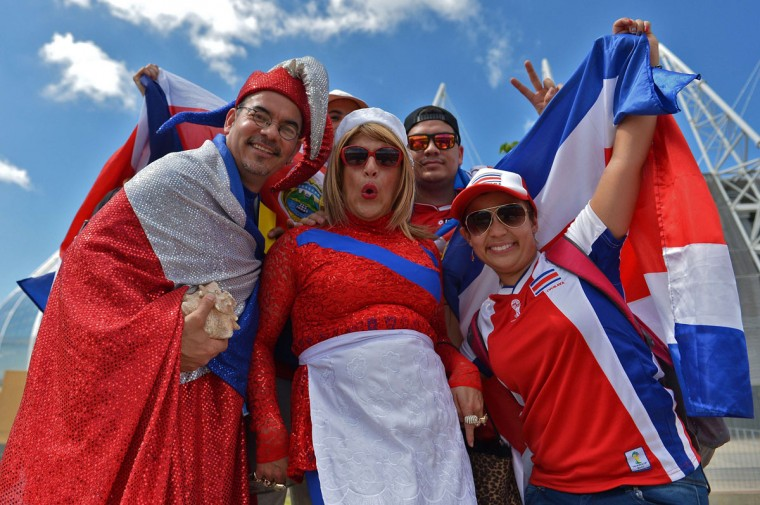 Costa Rica's supporters pose in front of Castelao Stadium in Fortaleza ahead of the Group D football match between Uruguay and Costa Rica during the 2014 FIFA World Cup on June 14, 2014. (Gabriel Bouys/AFP/Getty Images)