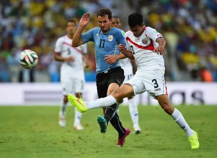 Christian Stuani of Uruguay and Giancarlo Gonzalez of Costa Rica battle for the ball during the 2014 FIFA World Cup Brazil Group D match between Uruguay and Costa Rica at Castelao on June 14, 2014 in Fortaleza, Brazil. (Photo by Laurence Griffiths/Getty Images)
