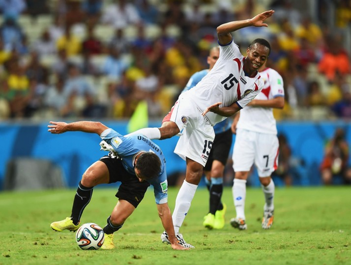 Nicolas Lodeiro of Uruguay and Junior Diaz of Costa Rica fight for the ball during the 2014 FIFA World Cup Brazil Group D match between Uruguay and Costa Rica at Castelao on June 14, 2014 in Fortaleza, Brazil. (Photo by Laurence Griffiths/Getty Images)