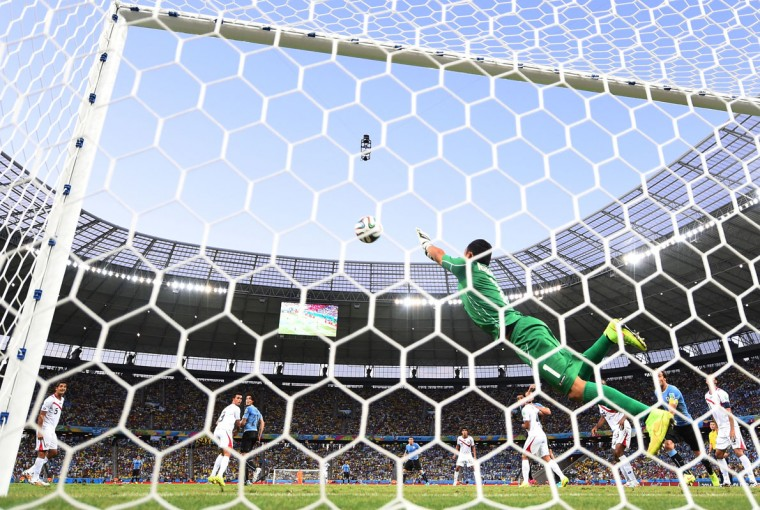 Keylor Navas of Costa Rica dives to make a save during the 2014 FIFA World Cup Brazil Group D match between Uruguay and Costa Rica at Castelao on June 14, 2014 in Fortaleza, Brazil. (Photo by Laurence Griffiths/Getty Images)