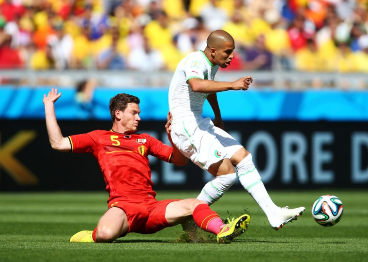 Jan Vertonghen of Belgium challenges Sofiane Feghouli of Algeria during the 2014 FIFA World Cup Brazil Group H match between Belgium and Algeria at Estadio Mineirao on June 17, 2014 in Belo Horizonte, Brazil. (Photo by Jeff Gross/Getty Images)