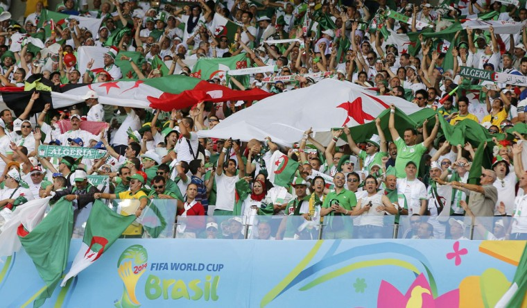 Fans of Algeria cheer before the start of their 2014 World Cup Group H soccer match against Belgium at the Mineirao stadium in Belo Horizonte