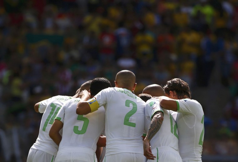 Algeria players huddle before the 2014 World Cup Group H soccer match between Belgium and Algeria at the Mineirao stadium in Belo Horizonte June 17, 2014. (Michael Dalder/Reuters)