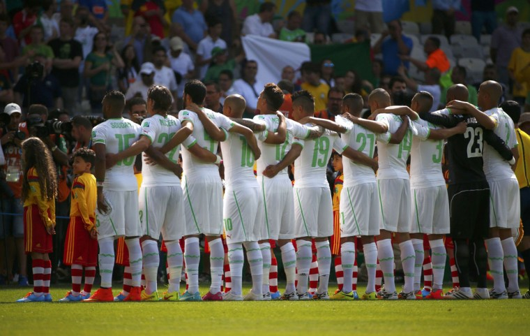 Algeria players stand for the anthem before the 2014 World Cup Group H soccer match between Belgium and Algeria at the Mineirao stadium in Belo Horizonte June 17, 2014. (Michael Dalder/Reuters)