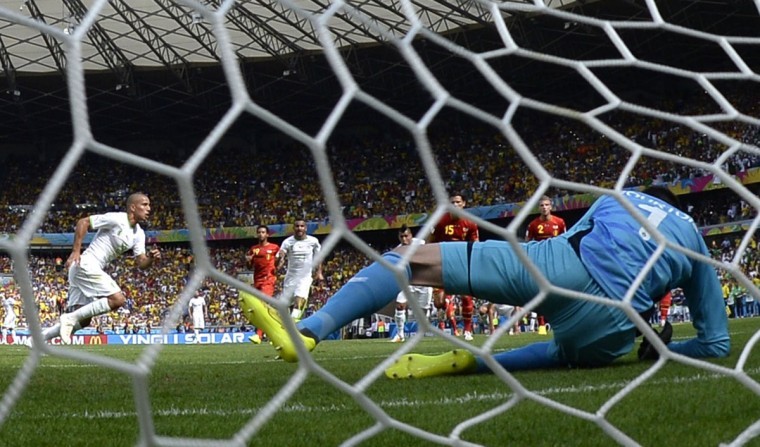 Belgium's goalkeeper Thibaut Courtois (R) lays on the pitch after failing to save a penalty shot by Algeria's forward Sofiane Feghouli (L) during a Group H football match between Belgium and Algeria at the Mineirao Stadium in Belo Horizonte during the 2014 FIFA World Cup on June 17, 2014. (Martin Bureau/AFP/Getty Images)