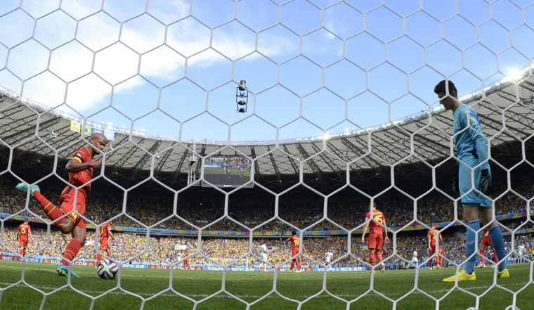 Belgium's goalkeeper Thibaut Courtois (R) looks on after Algeria scored a penalty shot by Algeria's forward Sofiane Feghouli (L) during a Group H football match between Belgium and Algeria at the Mineirao Stadium in Belo Horizonte during the 2014 FIFA World Cup on June 17, 2014. (Martin Bureau/AFP/Getty Images)