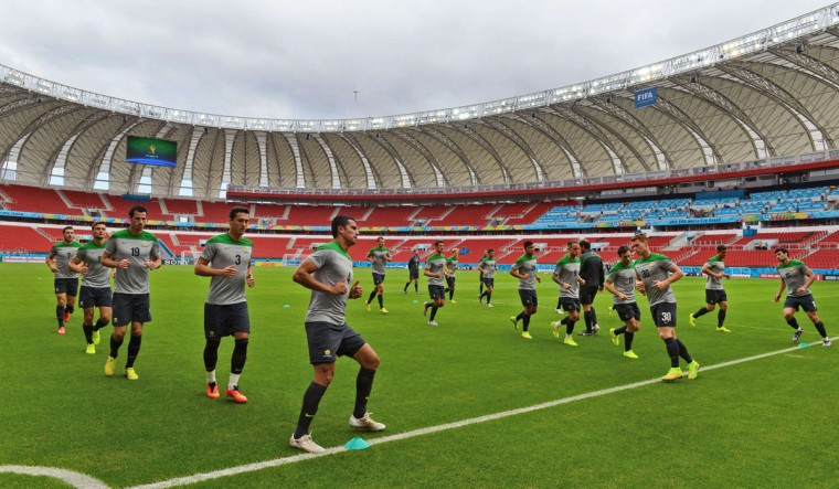 Australian players go through stretching exercises led by Australia's forward Tim Cahill (5L) during a final pre-match training session at The Beira-Rio Stadium in Porto Alegre on June 17, 2014. Australia take on the Netherlands on June 18, for their second Group B match of the 2014 FIFA World Cup in Porto Alegre. (William West/AFP/Getty Images)