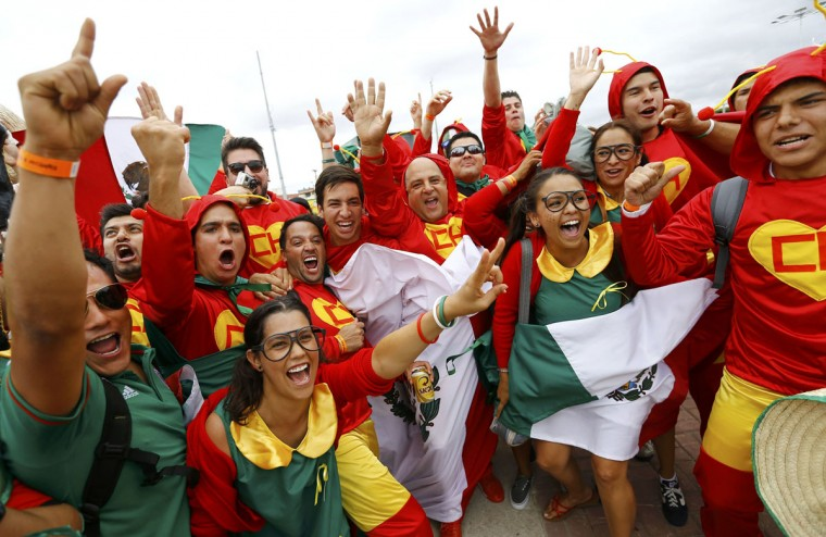 Supporters of Mexico cheer outside the stadium prior to their team's Group A World Cup soccer match against Brazil in Fortaleza June 17, 2014. (Kai Pfaffenbach/Reuters)