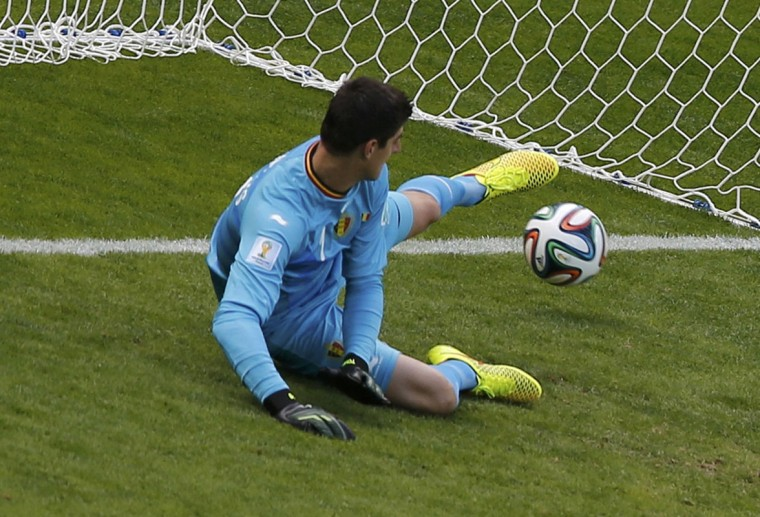 Belgium's Thibaut Courtois fails to save a penalty goal by Algeria's Sofiane Feghouli (unseen) during their 2014 World Cup Group H soccer match at the Mineirao stadium in Belo Horizonte June 17, 2014. (Leonhard Foeger/Reuters)