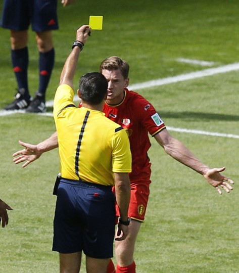 Belgium's Jan Vertonghen is shown the yellow card by referee Marco Rodriguez of Mexico after a foul which resulted in a penalty goal for Algeria during their 2014 World Cup Group H soccer match at the Mineirao stadium in Belo Horizonte June 17, 2014. (Leonhard Foeger/Reuters)