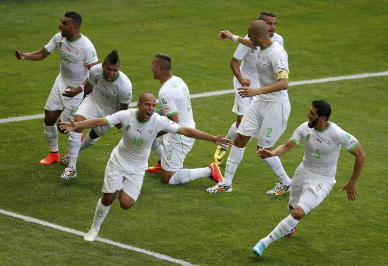 Algeria's Sofiane Feghouli (10) celebrates scoring a goal during their 2014 World Cup Group H soccer match against Belgium at the Mineirao stadium in Belo Horizonte June 17, 2014. (Leonhard Foeger/Reuters)
