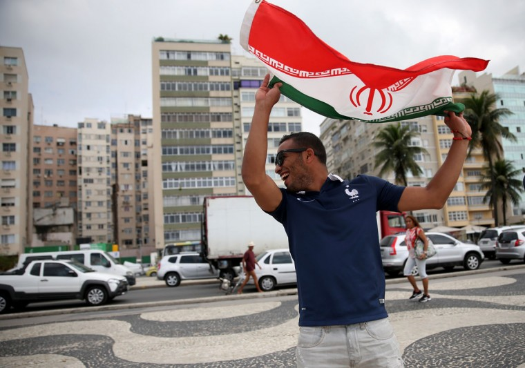 Iranian soccer team fan, Hooman Moossavi, from France, waves an Iranian flag as he visits Copacabana beach while waiting for the start of the World Cup tournament on June 11, 2014 in Rio de Janeiro, Brazil. Brazil continues to prepare to host the World Cup which starts on June 12th and runs through July 13th. (Photo by Joe Raedle/Getty Images)