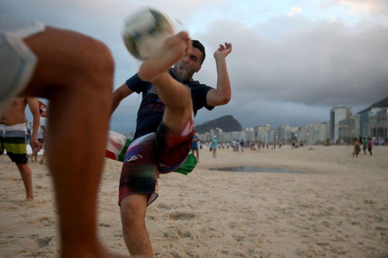 Algerian soccer team fan, Smail Belaroussi, from Algeria, kicks a soccer ball as he visits Copacabana beach while waiting for the start of the 2014 FIFA World Cup on June 11, 2014 in Rio de Janeiro, Brazil. Brazil continues to prepare to host the World Cup which starts on June 12th and runs through July 13th. (Photo by Joe Raedle/Getty Images)