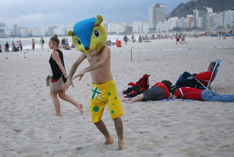 Argentinean soccer team fan, Juan Pablo, from Argentina, wears a replica head of the FIFA mascot as he enjoys Copacabana beach while waiting for the start of the 2014 FIFA World Cup on June 11, 2014 in Rio de Janeiro, Brazil. Brazil continues to prepare to host the World Cup which starts on June 12th and runs through July 13th. (Photo by Joe Raedle/Getty Images)