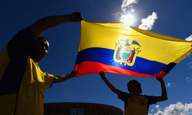 Ecuador fans wave their flag outside of the National Stadium, ahead of their opening game of the 2014 FIFA World Cup against Switzerland on sunday, on June 12, 2014 in Brasilia, Brazil. (Photo by Stu Forster/Getty Images)
