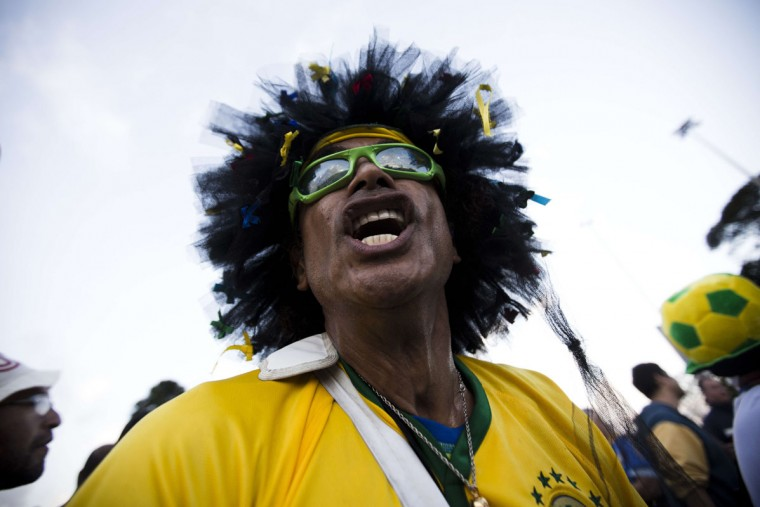 A Brazilian fan plays a drum as he shouts to support his team outside the Corinthians Arena in Sao Paulo, on June 11, 2014, ahead of the 2014 FIFA World Cup. (Behrouz Mehri/AFP/Getty Images)